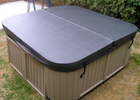 Locks into wood on portable spa cover
